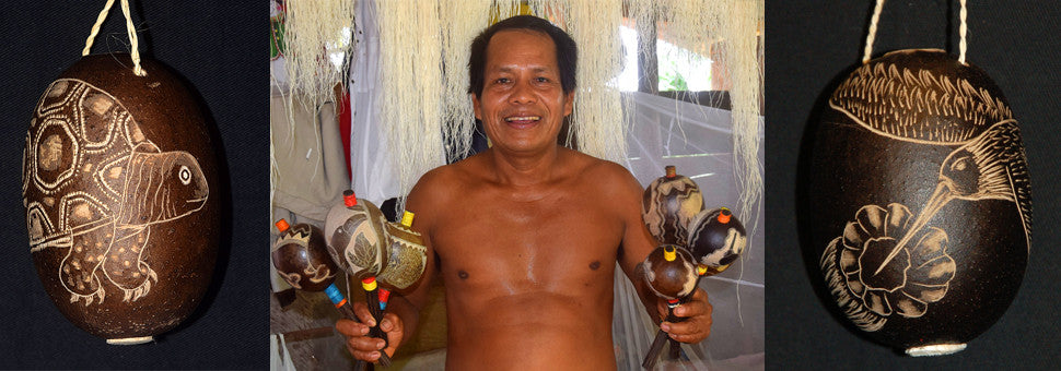 Bora artisan Rider Velasquez with maracas and calabash Christmas tree ornaments and rattes.