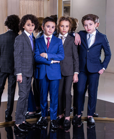 4 boys in suits