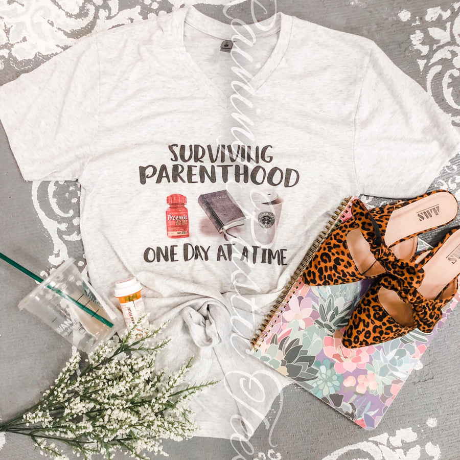 Surviving parenthood tee