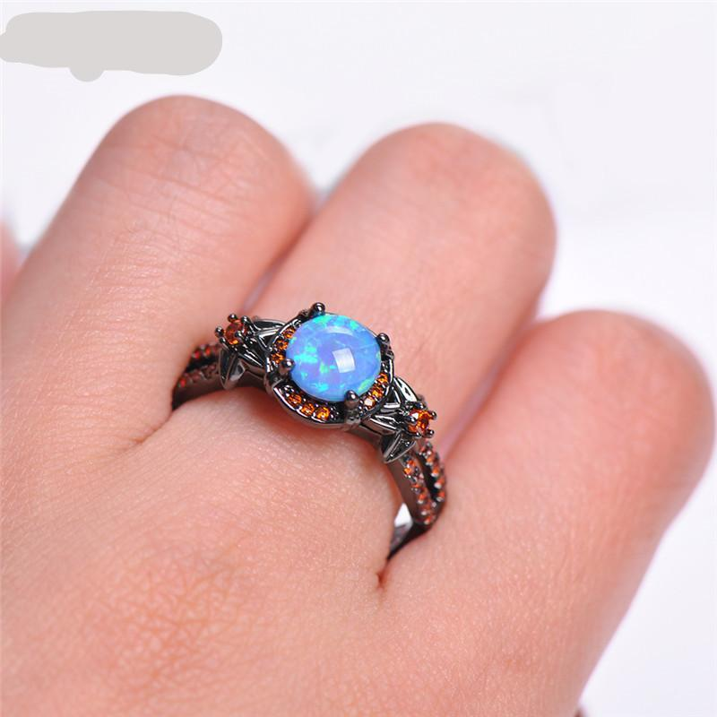 Flower Blue Fire Opal Ring with Red Cubic Zircons and Black Gold Filled