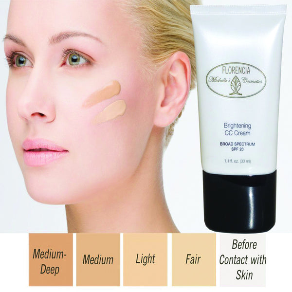 Woman with two shades of CC Cream Brightening SPF 20 on her cheek, a bottle of CC Cream Brightening SPF 20 and boxes with four shades from fair to medium-deep.
