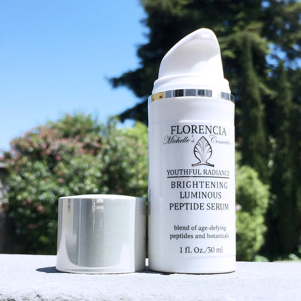A bottle of Brightening Luminous Peptide Serum - Youthful Radiance.