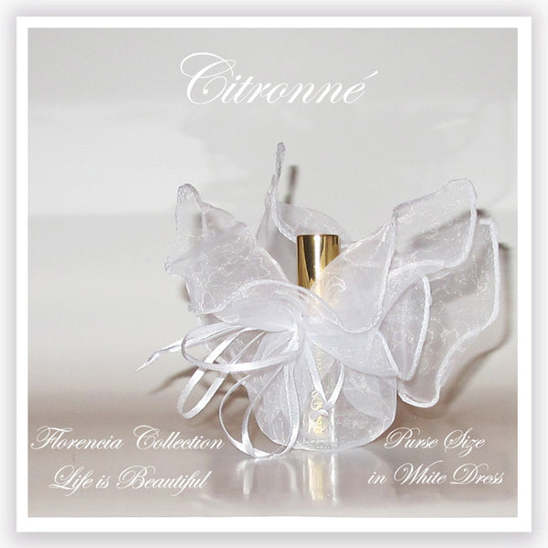Bottle of perfume in a transparent white gift bag.