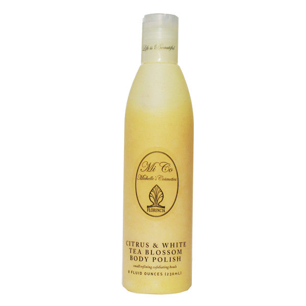 A bottle of Citrus & White Tea Blossom Body Polish