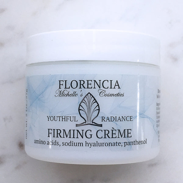 A container of Firming Cream.