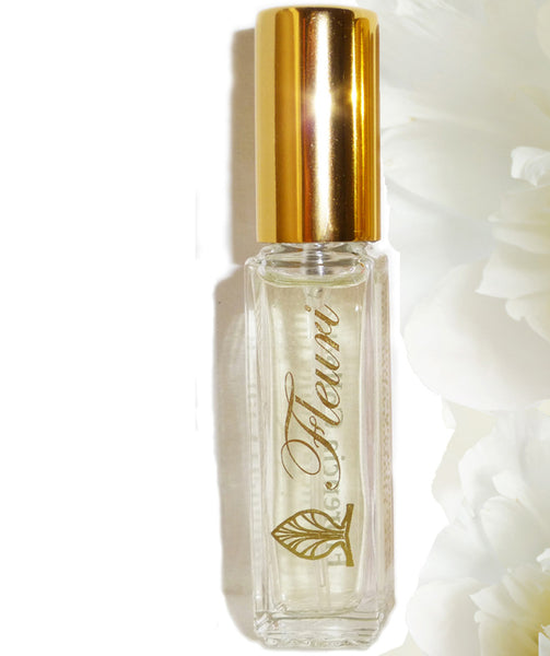 Fleuri Perfume bottle with a gold top.