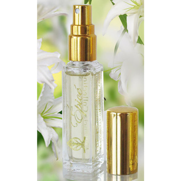 A bottle of Épicé Fragrance spray with a clear bottle and gold spray and a gold lid sitting next to the bottle.