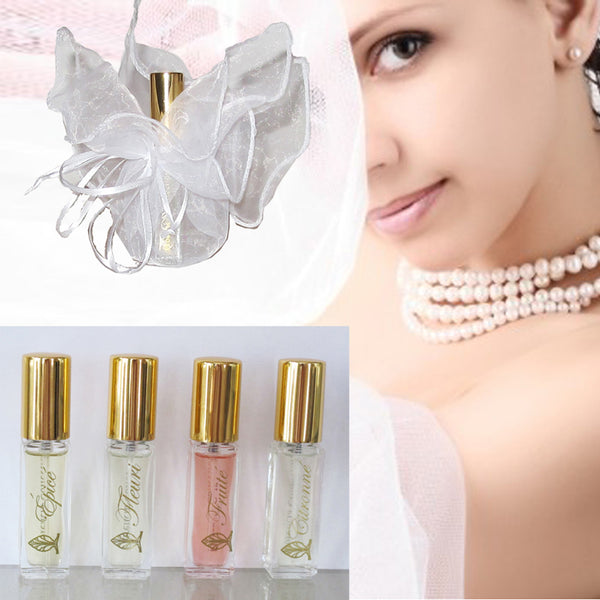 Five bottles of perfume. A bottle of perfume wrapped in a transparent white gift bag.