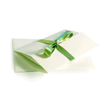 Gift certificated folded with a green ribbon.