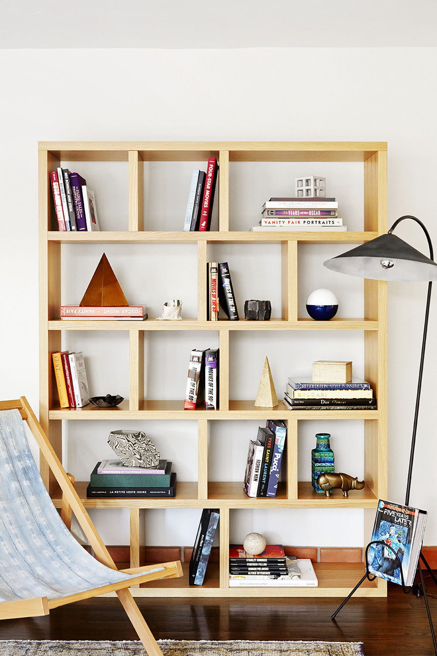 Light reading in a light wooden bookshelf.Interior Design by Consort. Photo: Aaron Fallon