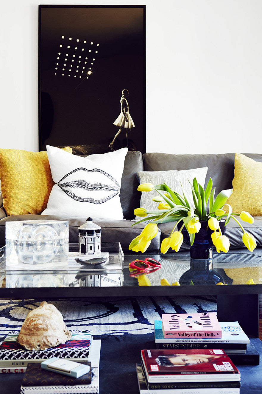 Mellow yellow pops in a mellow living room.Interior Design by Consort. Photo: Christopher Patey