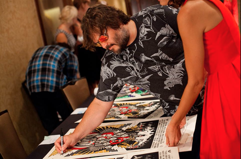 Jack Black signing the print.