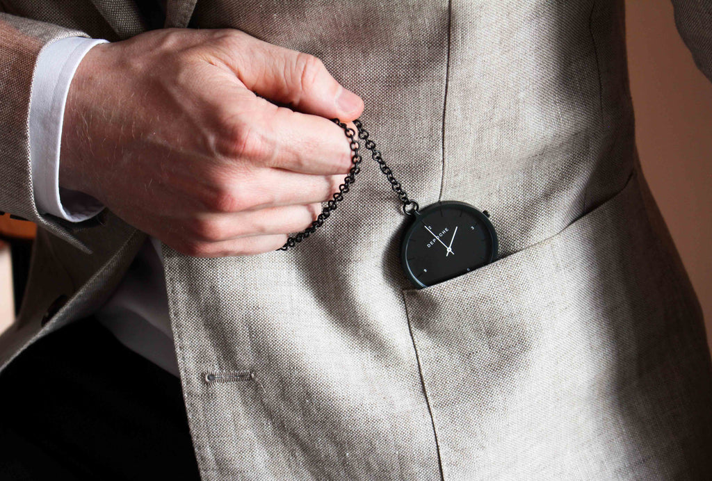 Depoche black pocket watch in blazer pocket