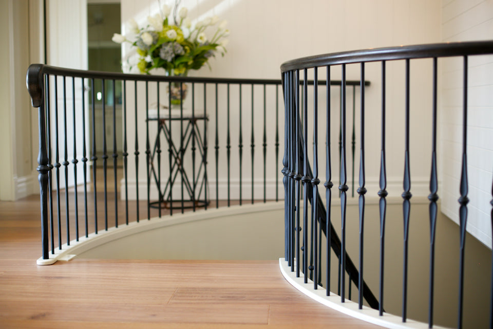 french inspired iron and wood railing