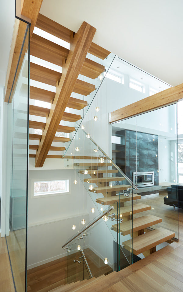 White oak monostringer with steel and glass railing