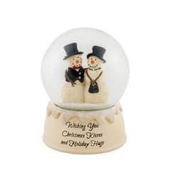 Christmas snow globe with snowman couple inside