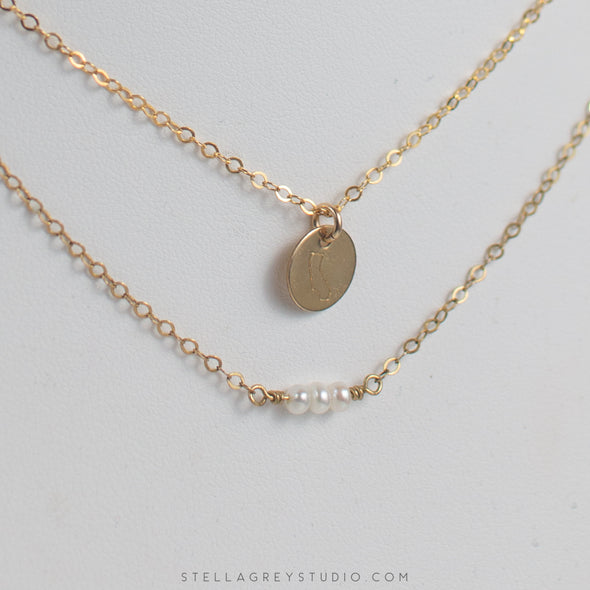tiny pearl and california disc necklaces