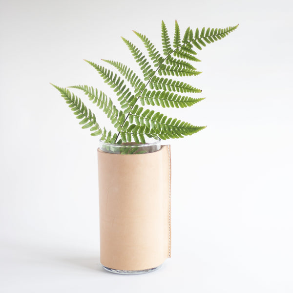 leather vase, leather wrapped vase, vegetable tanned leather, hand stitched vase, saddle stitch vase, leather home decor, minimalism design, chic home, flashes of delight, stella grey studio, stellagreystudio, stella loves you, stellalovesyou