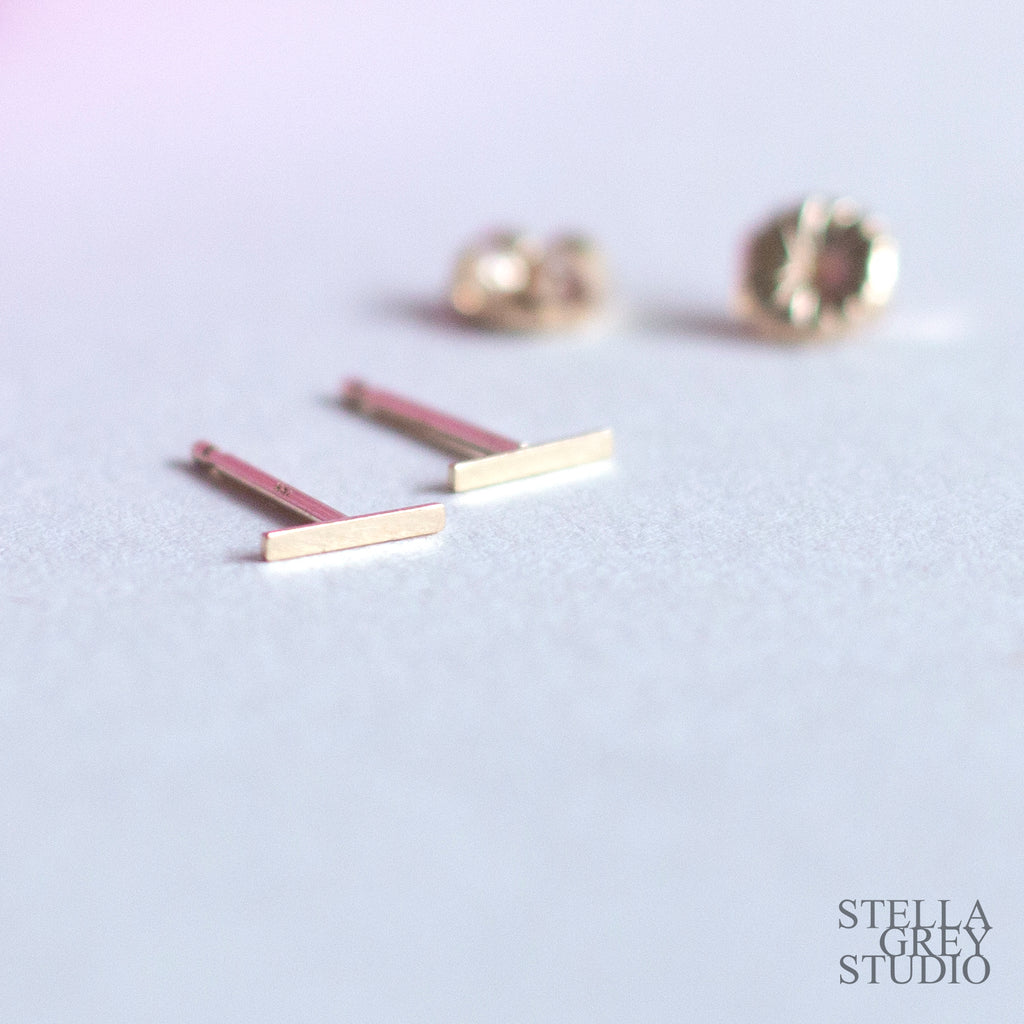 tiny solid gold studs, tiny gold earrings, solid gold studs, solid gold studs, solid gold earrings, solid gold bar earrings, stella grey, stella grey studio, stella loves you, stellalovesyou