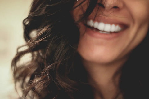 women with long hair smiling
