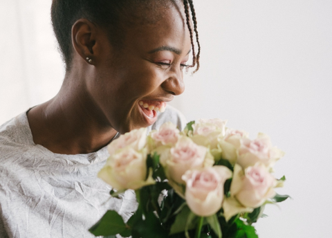 girl smiling with flower bouquet in hand