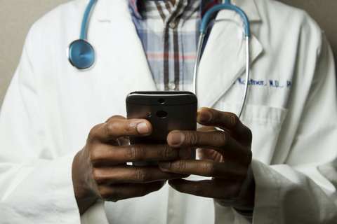 doctor checking his mobile