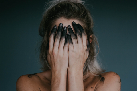 girl hiding her face with hands