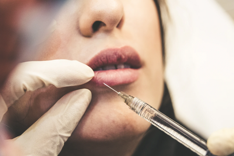 doctor treating dry lip patient