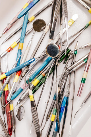 pile of dental tools on a table