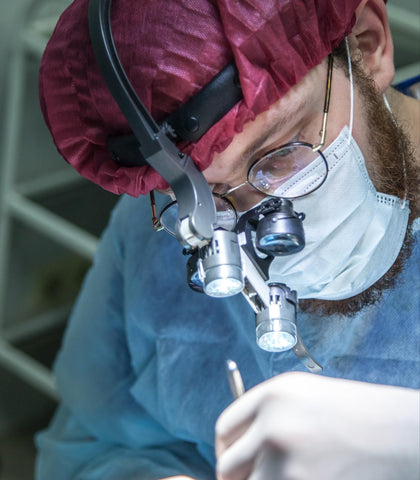 Surgeon performing surgery on a patient