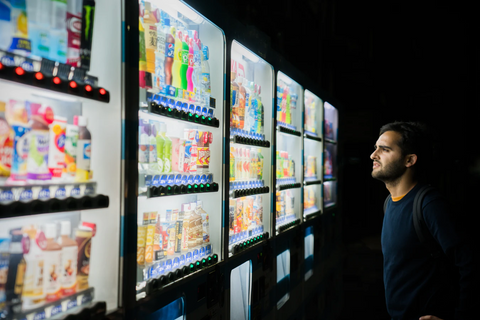 Man looking into vending machines