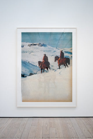 two man riding horse over the snow