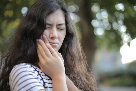 girl suffering from toothache