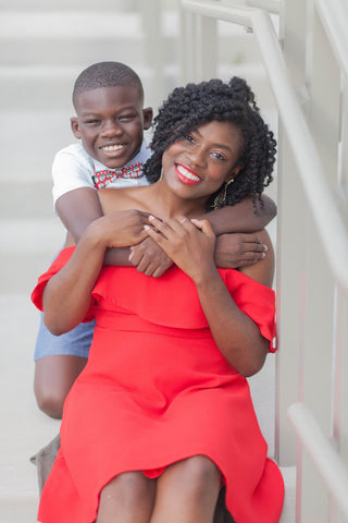 black mom and her son smiling