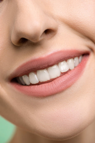 smiling face with straight set of teeth