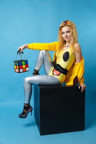 gorgeous young lady sitting above a cube