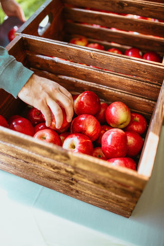 wooden boxes full of fresh apples