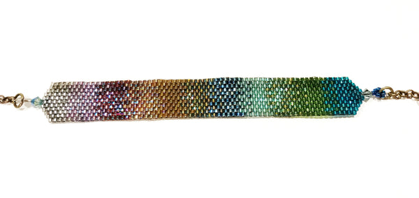 Onburu bracelet in shades of blues, greens, golds and lavenders