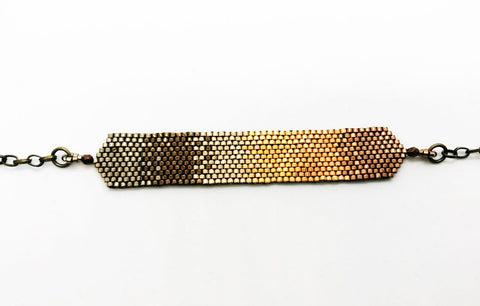 Onburu bracelet in shades of rose gold to gold to dark silver