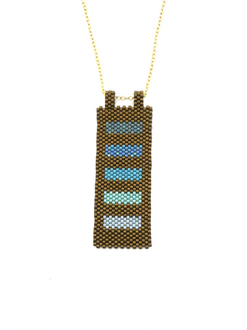 Ato Necklace in shades of blue trimmed in brown