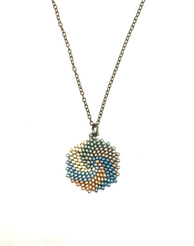 Enkei Necklace in shades of blues, cream, gold and silver