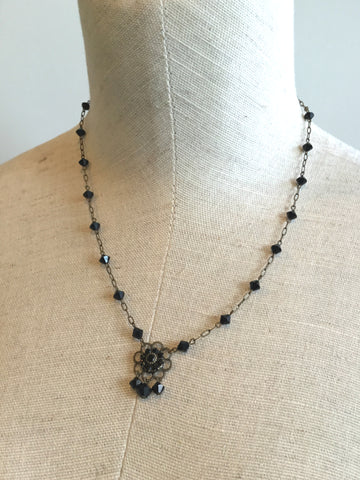 vintage gothic black glass and brass necklace