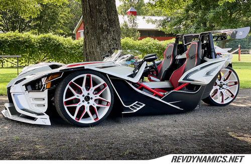 Polaris Slingshot Pearl White and Indy Red Two Tone Rims on air ride suspension