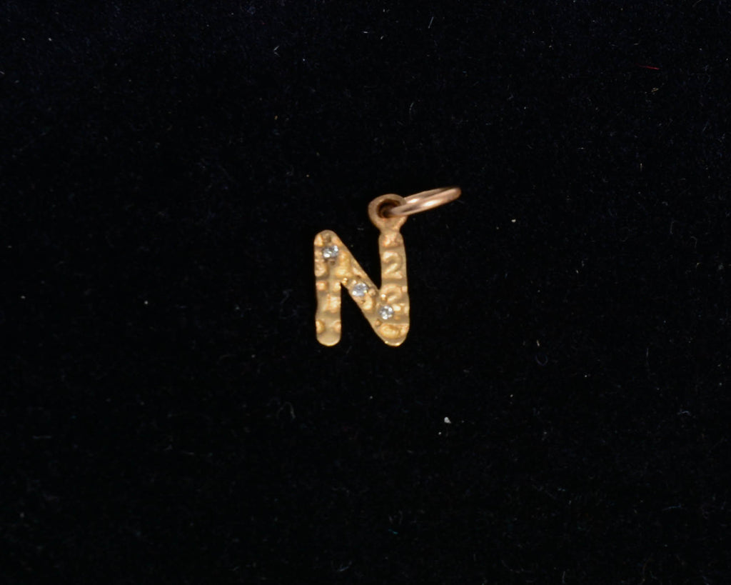 "Block Letter ""N"" with Diamond"