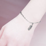 leaves charm bracelet with card