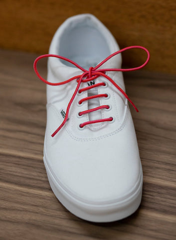 White, low top vans with pink Benjo's laces