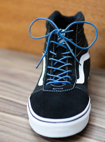 Black high top vans with two tone nylon laces