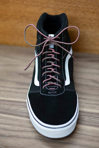 Black high top vans with two tone shoe laces