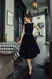 black fit and flare vintage inspired 1950s dress with boat neck and v back