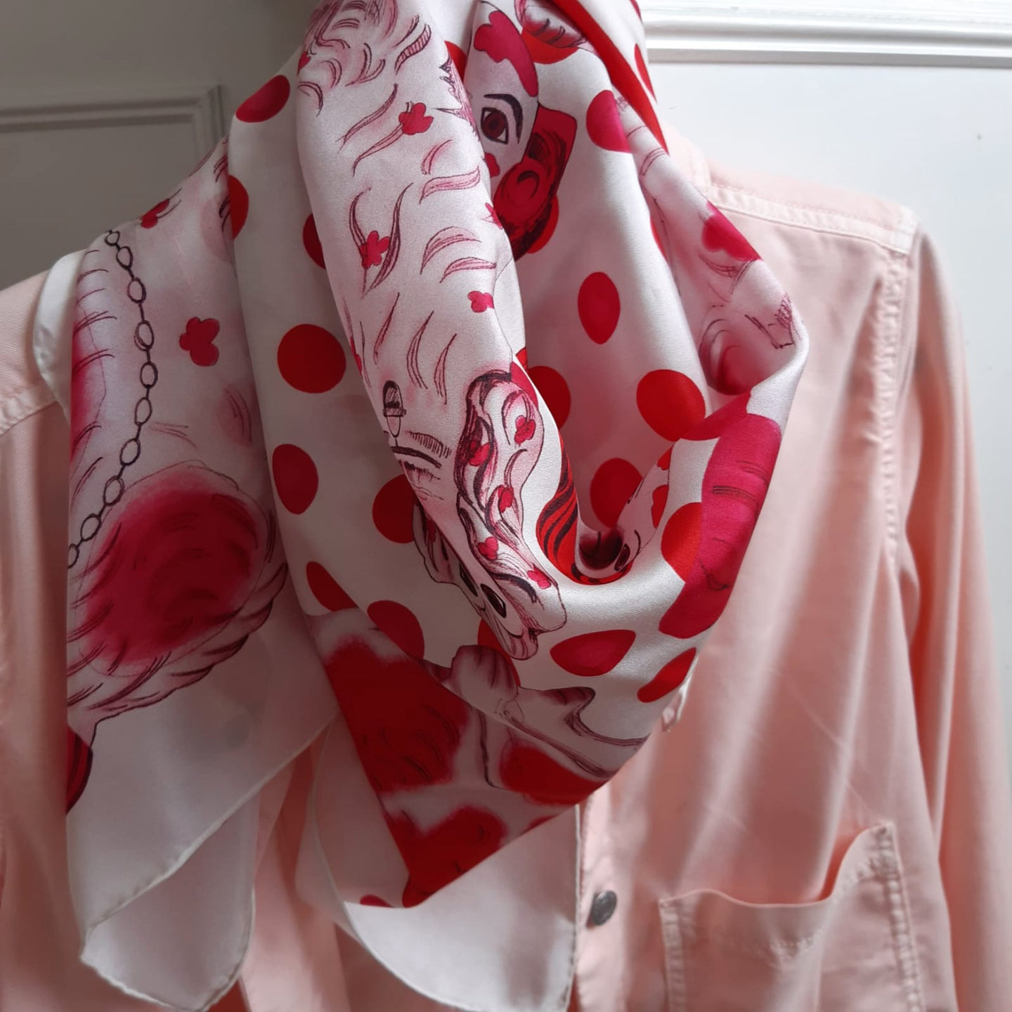 red and white dog art scarf on pink shirt